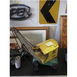 1950 Lincoln Press Steel Crane Toy