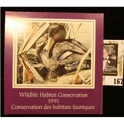 1991 Canadian Wildlife Habitat Conservation $8.50 Stamp in original mint holder.
