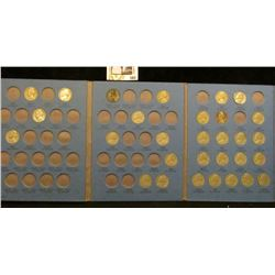 1938-61 Partial Jefferson Nickel set in a blue Whitman folder. Includes (1) Silver War Nickels.