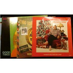 Several Elvis Presley 33 1/3 R.P.M. albums & a Sherwin Linton Christmas Memories album.