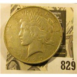 1927 D U.S. Silver Peace Dollar.