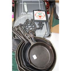 Several Cast Iron Fry Pans and Cookie Sheets
