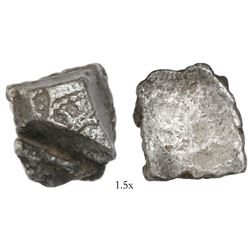 "Small silver ""plata corriente"" cut piece with partial tax stamp visible, 12.58 grams."