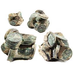 Large clump of 73(+/-) Spanish colonial bust 8 reales of Charles III (one loose).