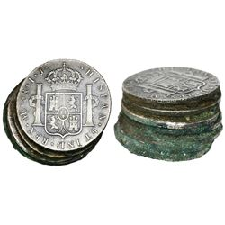 Encrusted stack of seven Lima, Peru, bust 8 reales, Charles IV, assayer IJ (probably all dated 1800)