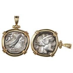 """Attica, Athens, AR tetradrachm """"owl,"""" mounted owl-side out in 14K gold bezel with shackle bail."""