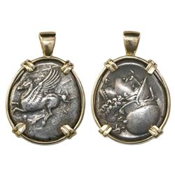 Corinth, Corinthia, AR stater, 4th century BC, mounted pegasus-side out in 14K gold bezel.