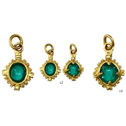 Tiny but ornate gold earring with high-quality cabochon emerald (approx. 1/2 carat) from the Capitan