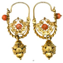 Matching pair of ornate gold and red coral earrings from an unidentified ca.-1750s wreck in the Rive