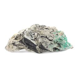 Natural Colombian emerald in stone matrix with pyrite.