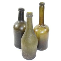 Lot of three bottles: One Dutch long neck, one French wine (ca. 1780), and one English cylinder (ca.