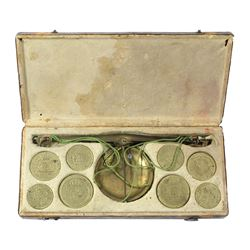 Set of Italian scale and coin weights, ca. 1805, in original, leather-lined wooden case.