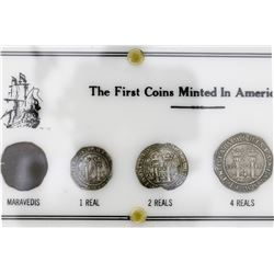 "Four-coin denomination set in holder printed with ""The First Coins Minted in America,"" consisting of"