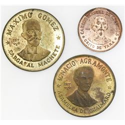 Lot of three Cuba off-metal brass test strikes, 1977: 20 pesos (2), Gomez and Agramonte; 1 peso, Ces
