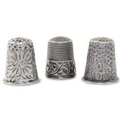 Lot of three ornate sterling silver thimbles, late 1800s-early 1900s.