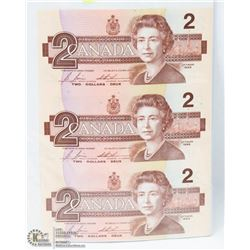 SHEET OF 3 UNCUT 1986 CANADIAN $2 BILLS.