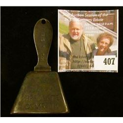 """Advertising copper bell – """"Ring for the Dairy Products Company"""" on one side, a cow on opposing long"""