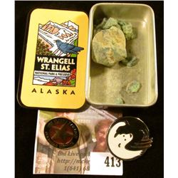 Souvenirs from a trip to Alaska – a box from Wrangell St. Elias National Park, a GoldStar Service pi
