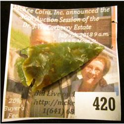 Arrowhead made of transluscent green and brown quartz