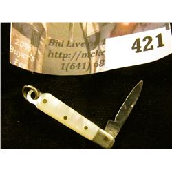 "Miniature pocket knife with mother of pearl handle, blade marked GERMANY, total length 2"", blade len"