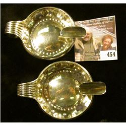 (2) (Silver? Platinum?) Cartier ashtrays, marked CARTIER RL 950 M MADE IN FRANCE. Scarce, heavy, 113