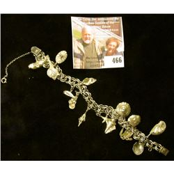 "8"" silver double ring link charm bracelet with 14 shells and whales sterling charms. Well made with"