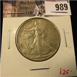 989 . 1939 Walking Liberty Half Dollar, AU, value $25