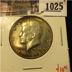 1025 . 1968-D Kennedy Half Dollar, UNC toned, value $10