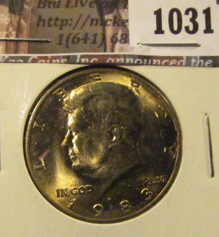 1031   1983-P Kennedy Half Dollar, BU toned, struck through grease,