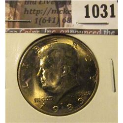 1031 . 1983-P Kennedy Half Dollar, BU toned, struck through grease,