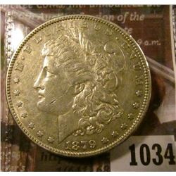 1034 . 1879 Morgan Silver Dollar, AU, value $40