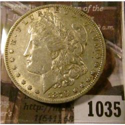 1035 . 1879-O Morgan Silver Dollar, AU, value $47
