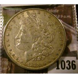 1036 . 1880-O micro O Morgan Silver Dollar, AU, value $48
