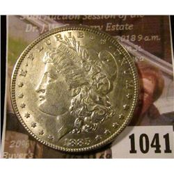 1041 . 1885 Morgan Silver Dollar, AU+, light wear, value $39