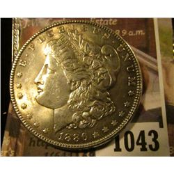 1043 . 1886 Morgan Silver Dollar, AU+, value $39