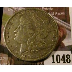 1048 . 1892 Morgan Silver Dollar, XF, better date, value $53