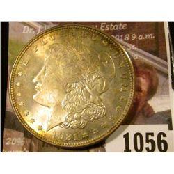 1056 . 1921 Morgan Silver Dollar, BU toned, MS63 value $50, MS64 va