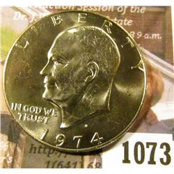 1073 . 1974-D Eisenhower Dollar, BU toned from a Mint Set, MS63 val
