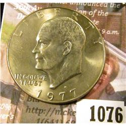 1076 . 1977-D Eisenhower Dollar, BU toned from a Mint Set, MS63 val