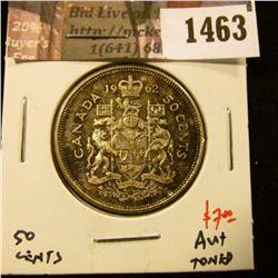 1463 . 1962 Canada 50 Cents, AU+ toned, value $7