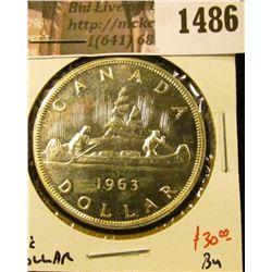 1486 . 1963 Canada Silver Dollar, BU, value $30+
