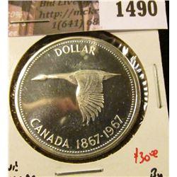 1490 . 1967 Canada Silver Dollar, BU, value $30+