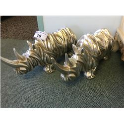 PAIR OF SILVER RHINO SCULPTURES