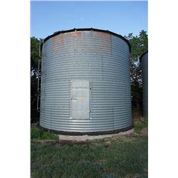2300 BUSHEL BUTLER GRAIN BIN WITH AIR FAN ON CEMENT NO FLOOR. BINS ARE LOCATED IN RM OF MILDEN. TRAV