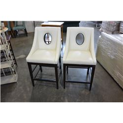 2 WHITE LEATHER PORTHOLE CHAIRS