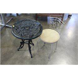 CAST IRON PATIO TABLE WITH GLASS TOP AND SMALL METAL CHAIR