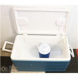 LARGE BLUE AND WHITE COOLER COMES WITH WATER JUG