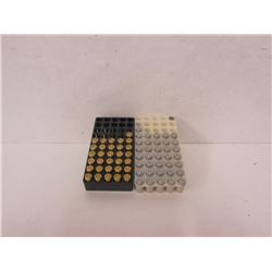 67 ROUNDS OF 380 AUTO AND ONE PIECE OF BRASS