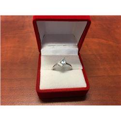 BLUE TOPAZ & DIAMOND RING. LIVELY SKY BLUE, PEAR CUT, 2 SIDE DIAMONDS, STERLING SILVER