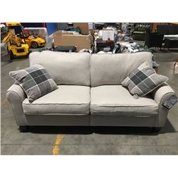LIGHT BEIGE UPHOLSTERED COMPACT 2 SEATER APARTMENT SIZE SOFA WITH 2 THROW CUSHIONS